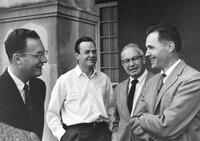 Robert Bacher enjoys an informal conversation with three eminent physicists