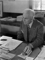 Robert A. Millikan at his desk