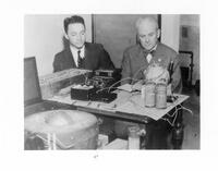 Robert A. Millikan and Victor Neher with equipment