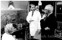 Jim Hudspeth in lab with Dr. and Mrs. DuBridge