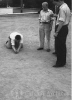 Students playing marbles